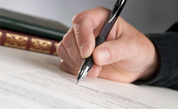 Hand signing title insurance