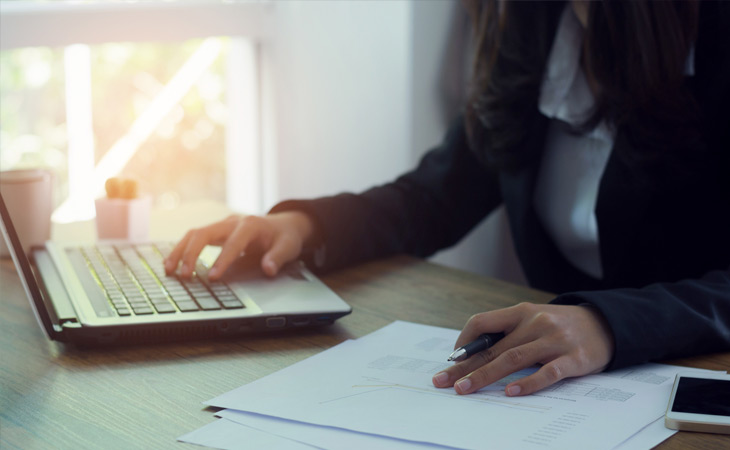 Woman Using Laptop to Research Wills